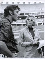#15     Taffy Wilber, radio journalist for KMOX in St. Louis,  interviews Joe Namath at Busch Stadiu